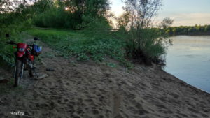 The steep sandy bank of the Vyatka River, overgrown with grass
